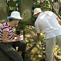 Cleaning and reading a tombstone